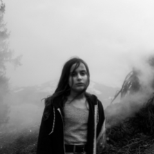 Family quarantining in the mountains during the Covid-19 pandemic. Luna, 10. Switzerland, 2020. ©Paolo Pellegrin/Magnum Photos